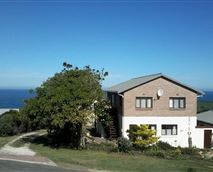 Northen/street view of house. See the sea views in the background