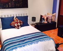 Double bed. Flat screen TV. Full satellite tv (DSTV). DVD player. Free wifi.