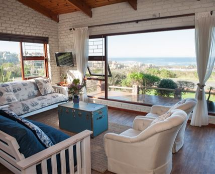 Lounge with stunning sea views with fire place
