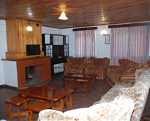 The lobby with a beautiful fire place seats 10 - 15 persons