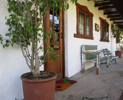 Patio and entrances to Cottages © Nico Schamrel
