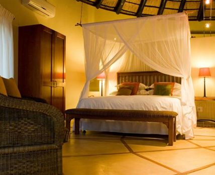 All our suites are like this one, King Size Beds with mosquito nets and fine linen.......