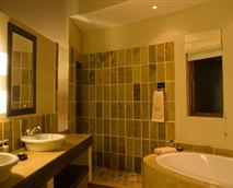 Our bathrooms are designed to pamper and please and features a bath good enough for two, an open shower good enough for two, handbasins for two and a private loo.