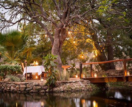 Romantic dining at the foot of the bridge.  © Em Gatland
