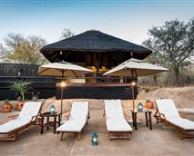 There are two swimming pools with sun loungers at River Camp. © Em Gatland