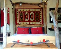 Four poster queen size bed with plenty of candle and fairy light to set ambiance or be romantic