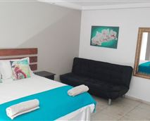 This room includes air conditioner, en suite, OVHD TV, mini fridge & microwave