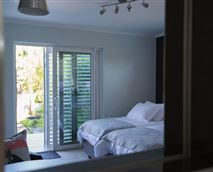 Bedroom with view to the garden