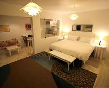 La.rge room with two single beds and sitting area