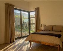 Morning light streams into the master bedroom
