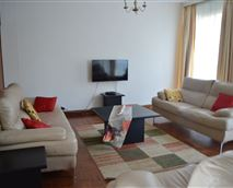 Equipped with luxurious leather latee couches, 40 Inch Samsung  TV,DSTV,Wi-FiTeak flooring
