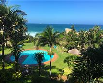 Magnificent view from View from the upstairs deck overlooking the complex pool, gardens and Indian Ocean