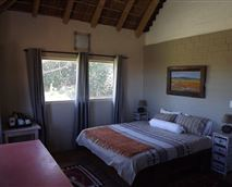 double-bed room with private bathroom in the main house, shared lounge and kitchen