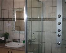 Unit 4 Bathroom with state of the are shower