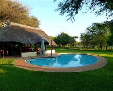 The tranquil pool is beautiful and inviting in this climate.