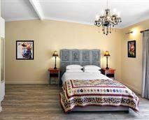 double bedroom with queen size bed & handmade quilt