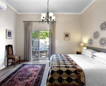with queen size bed, handmade quilt, en-suite double showers and private little garden