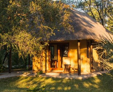 Thatched fully serviced units including a family room © DM Camps