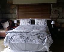 The bedroom has a double bed with a bathroom en-suite