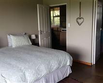 The second bedroom has twin beds with an en-suite bathroom