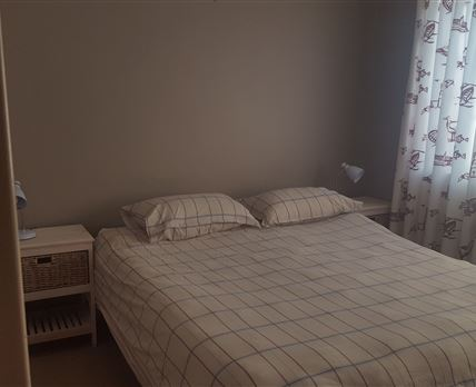 Double bed, bedside tables and reading lamps. Built ion cupboards not shown.