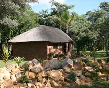 The comfortable Lapa is situated centrally amongst the chalets and rondavels.The Lapa has a fully-equipped kitchen, a sitting and dining area with DStv, and barbecue facilities.