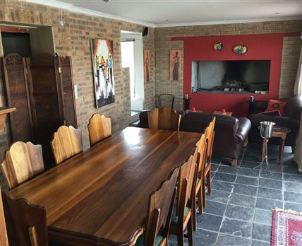 Cosy Dinning area and indoor fireplace and braai. Seats 10.
