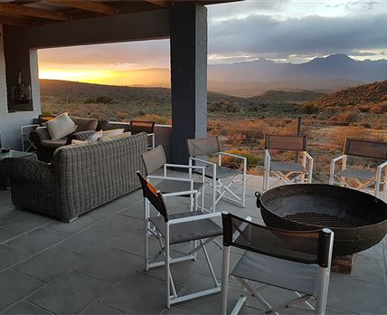 Patio with braai and Fire pit. The incredible view of Towerkop. © Rooiberg Safaris