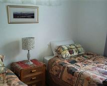 The second bedroom has two single beds and built-in cupboards © G Mitchell