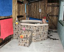 While you enjoy the warm jacuzzi, your man can do the braai, then you may allow him to join you - all in privacy.<br /><br />The Jacuzzi is drained, cleaned, refilled, sanitized and warmed up before your arrival.