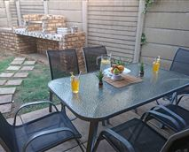 Private garden with braai and patio © Please note props are only for photo purposes