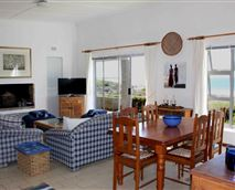 Lounge & Dining area with TV (and DSTV Family Package) and fireplace. © Beach Haven Cottage