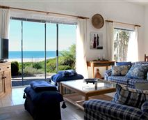 Lounge with view of the ocean. © Beach Haven cottage