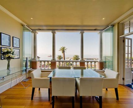 This is the breath taking view of the harbour from the dining room. The windows concertina open to allow you to smell the ocean and feel outside when dining.