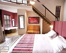 King sized bed with twin single beds on a mezzanine level