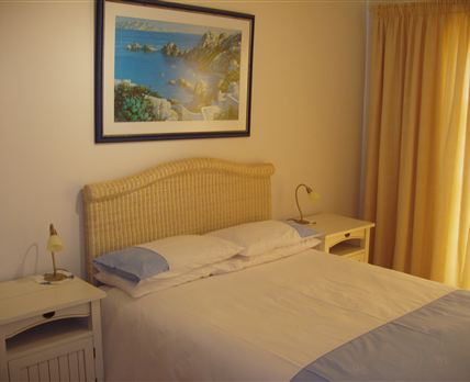 The main bedroom is very spacious and it has a double bed, a dressing table, an en-suite shower room and a private entrance onto garden.