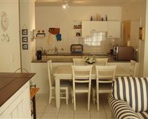 The kitchen is fully equipped complete with a washing machine, tumble-dryer and a dishwasher.