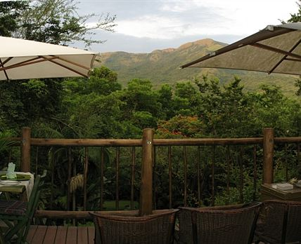 Enjoy meals on the main balcony with spectacular mountain & garden views
