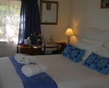 A bright sunny room with a comfortable double bed, percale linen, and fluffy white towels.