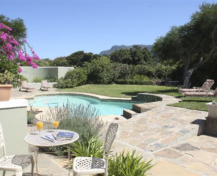 Our beautiful garden and swimming pool © Copyright Casbell House. All Rights Reserved.