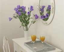Dressing Table, Mirror and Flowers. © Copyright Casbell House. All Rights Reserved.
