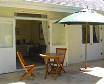 Cottage has a private garden and sunny terrace with teak loungers and umbrella
