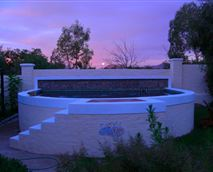 Evening colours over the pool, close to all rooms.