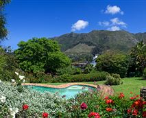 One of the two salt water swimming pools with the Table Mountain Range in the background.