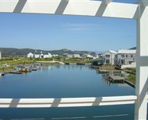This luxuriously appointed Knysna holiday home has prime waterfront position on prestigious Thesen Island.  This spacious home with beautiful views has four en-suite bedrooms and sleeps 10.  Three of the bedrooms have gorgeous views from their balconies.