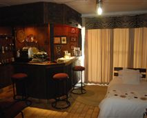 Room with twin beds and bar.