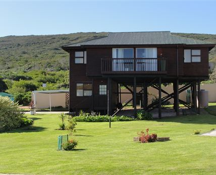The house is set in park-like garden in coastal suburb with views of the ocean and distant mountains.