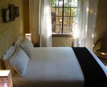 Attached to main house, this room has a separate bathroom, sharing a TV lounge and with its own private entrance.