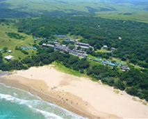 Aerial view of Mazeppa Bay main beach, Mazeppa Bay Beach House is the 2nd last house vwith a green roof in the picture.