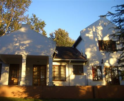 Gracious Cape Dutch Style House settled in the beautiful Hillcrest